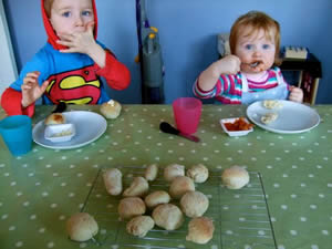 Children eating doughballs